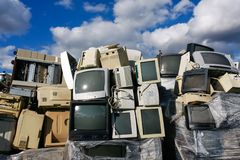 Modern electronic waste. Junked crts computer monitors, tvs and old printers for recycling or safe disposal recycling, any logos and brand names have been Royalty Free Stock Photo