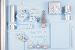 Modern elegance design for christmas decorations and gift boxes in pastel blue and silver metallic color with glitter ribbons. stock photography