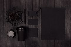Modern elegance workplace or concept design for restaurant and coffee shop advertising - black paper cup, cap, blank paper. royalty free stock photo