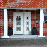 Modern, elegant front door of the house Stock Images