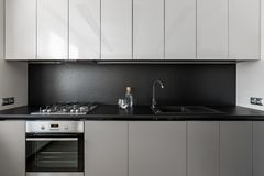 Modern and elegant gray kitchen unit royalty free stock photography
