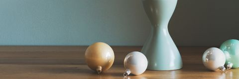 Modern and elegant simple nordic christmas decor in gold, white and turquoise royalty free stock photography
