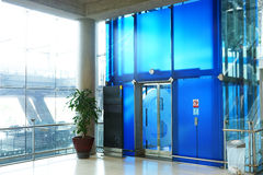 The modern elevator in the airport terminal Royalty Free Stock Photo