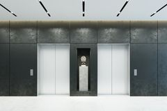 Modern elevator with closed doors in office lobby Royalty Free Stock Image