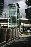 Modern elevator connecting street with a pedestrian bridge in Shiodome, Tokyo Royalty Free Stock Photo