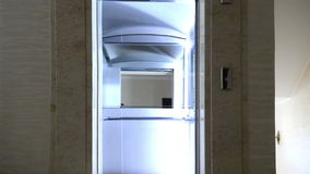 Modern elevator in the hall. Open and close door motion stock footage