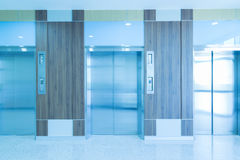 Modern elevator in hospital hallway.  stock image