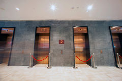Modern elevator in minimalist concrete building. Royalty Free Stock Photo