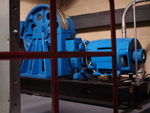 Modern Elevator Motor. And Traction systems for cable borne  elevators installed in elevator machine room typical in high rise office buildings Stock Photography