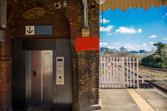 Modern elevator in an old train station Royalty Free Stock Photo