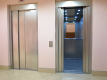 Modern elevator with opened and closed doors Stock Images