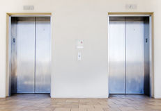 Modern elevators in office building. Lobby area, going up and down Stock Photo