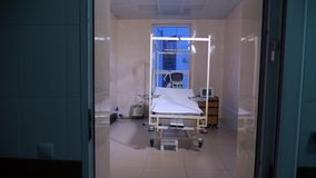 Fully-equipped hospital ward with empty bed. Burn clinic background. Empty hospital room with medical equipment. stock footage