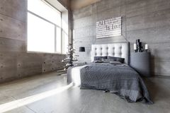 Modern empty bedroom in loft style with grey colors and wooden hand made Christmas tree with presents. Bed with grey blanket royalty free stock photos