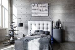 Modern empty bedroom in loft style with grey colors and wooden hand made Christmas tree with presents. Bed with grey blanket Royalty Free Stock Images