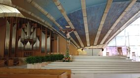 Modern empty church with jesus crist on the cross of San Giovanni Rotondo in Apulia - Italy