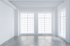 Modern empty loft room with big windows and concrete floor Stock Photography
