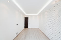 Modern empty room with a geometric pattern on the wall Stock Photo