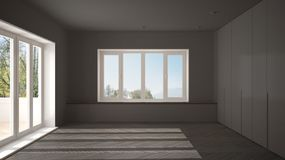 Modern empty space with big panoramic windows and wooden floor, minimalist gray architecture interior. Design royalty free stock image