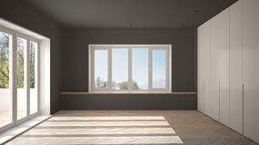 Modern empty space with big panoramic windows and wooden floor, minimalist white and gray architecture interior. Design royalty free stock image