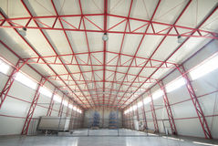 Modern empty storehouse. With red substructure Royalty Free Stock Photos
