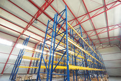 Modern empty storehouse. With steel construction in color Royalty Free Stock Images