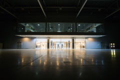 Modern empty storehouse. With lights at far side Royalty Free Stock Photography