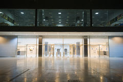 Modern empty storehouse. With lights at far side Stock Images