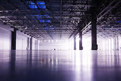 Modern empty storehouse. With lights at far side Royalty Free Stock Photos