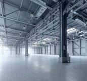 Modern empty storehouse. Interior of modern empty warehouse Royalty Free Stock Image