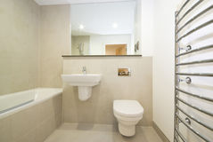 Modern en-suie bathroom in beige. Modern en-suite bathroom with natural stone tiled walls Stock Photography