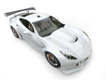 Modern endurance white sportscar - top down view. Isolated on white background Royalty Free Stock Photo