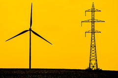 Modern Energy. Silhouettes Of A Wind Turbine And Electrical Power Station Transmitter Stock Images