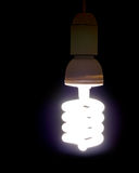 Modern energy saving light bulb, lit. Stock Photo