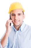 Modern engineer talking on smartphone Stock Image