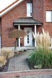 Modern entry door with a front garden Stock Photos