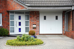 Modern entry door to the house. With front yard Royalty Free Stock Image