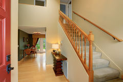Modern entry way to home with carpet staircase. Royalty Free Stock Photos