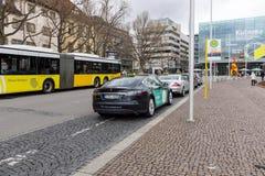 Modern and environmentally friendly taxi cars - Tesla Model S. Royalty Free Stock Photos