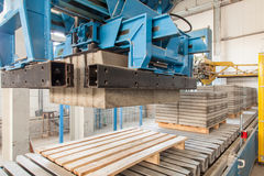Modern equipment at factory. Process of producing concrete blocks Royalty Free Stock Images