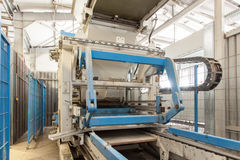 Modern equipment at factory. Process of producing concrete blocks Royalty Free Stock Photography