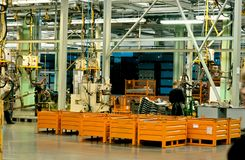 Modern equipment in the factory producing cars. Royalty Free Stock Photos