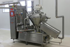 Modern equipment for milk processing. Room with modern stainless steel equipment for milk processing Royalty Free Stock Image
