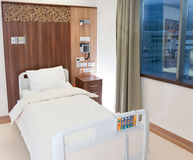 Empty modern hospital bed. Modern equipped and comfortable empty bed in hospital room Stock Images