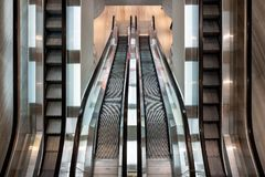 Modern escalator parallel moving in department store. Top view Stock Photography