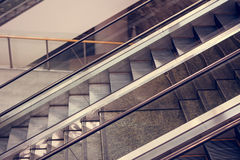 Modern escalator in shopping mall tone vintage Stock Photo