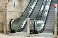Modern Escalators with blurred Motion. Side view of modern escalators with blurred motion up and down Royalty Free Stock Images