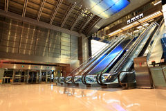 Modern escalators in hall Stock Photo
