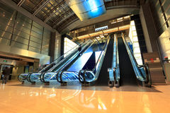 Modern escalators in lobby Stock Image