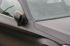 Close up of a Mercedes car with yellow detail. royalty free stock photography